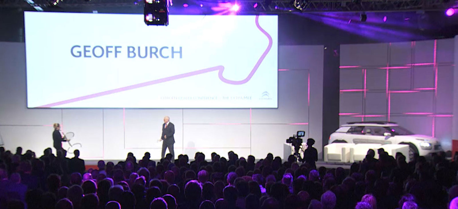 Geoff Burch on stage at Citroën event