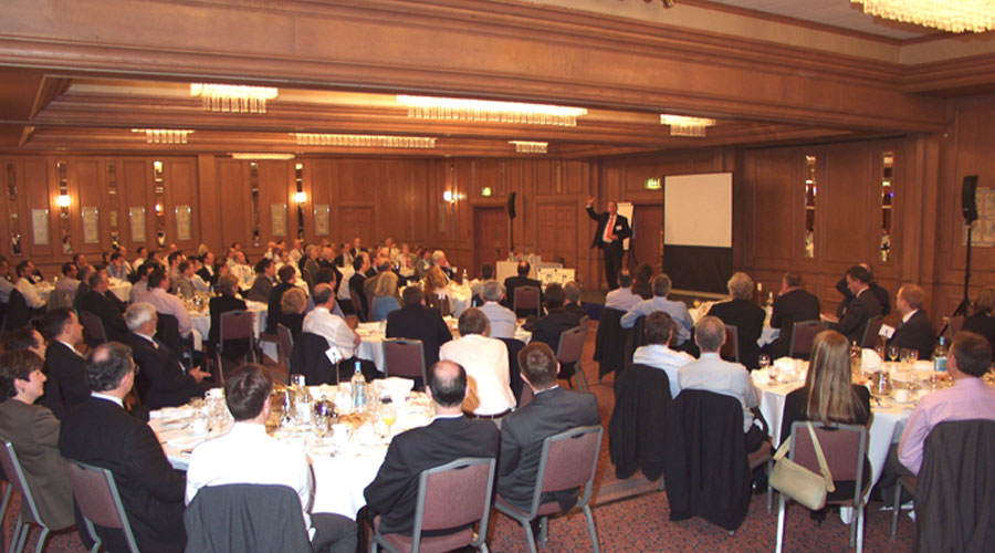 business speaker In conference in front of an audience of business people