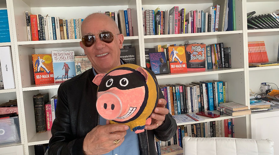 Holding a Pig with books in the background